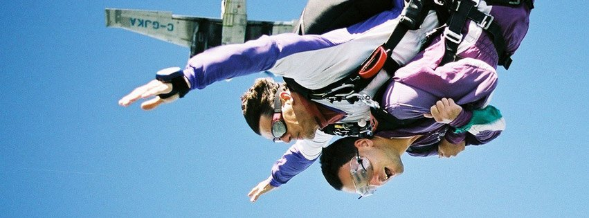 Man and son doing skydiving